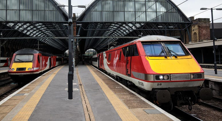 Virgin Trains East Coast trains sit at Kings Cross Station on May 16, 2018 in London, England.