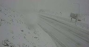 A snow-covered I-15 through the Cajon Pass on 12-26-19