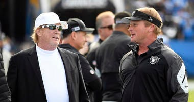 Oakland Raiders owner Mark Davis greets head coach Jon Gruden of the Oakland Raiders before the start of the game against Los Angeles Chargers at Dignity Health Sports Park on December 22, 2019