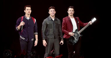 Nick Jonas, Joe Jonas, Kevin Jonas of the Jonas Brothers perform during 103.5 KISS FM's Jingle Ball 2019 - Show on December 18, 2019 in Chicago, Illinois.
