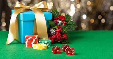 Red dice and poker chips in Christmas setting