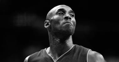 Kobe Bryant #24 of the Los Angeles Lakers looks on against the Washington Wizards in the first half at Verizon Center on December 2, 2015 in Washington
