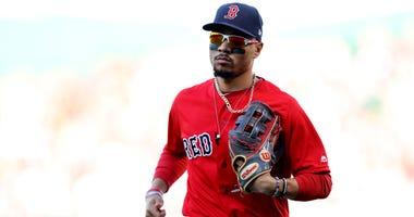 Mookie Betts #50 of the Boston Red Sox runs to the dugout during the fifth inning against the Baltimore Orioles at Fenway Park on September 29, 2019