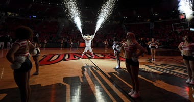 Pyrotechnics shoot from the hands of UNLV Rebels mascot Hey Reb before the team's game against the Texas State Bobcats at the Thomas & Mack Center on November 20, 2019