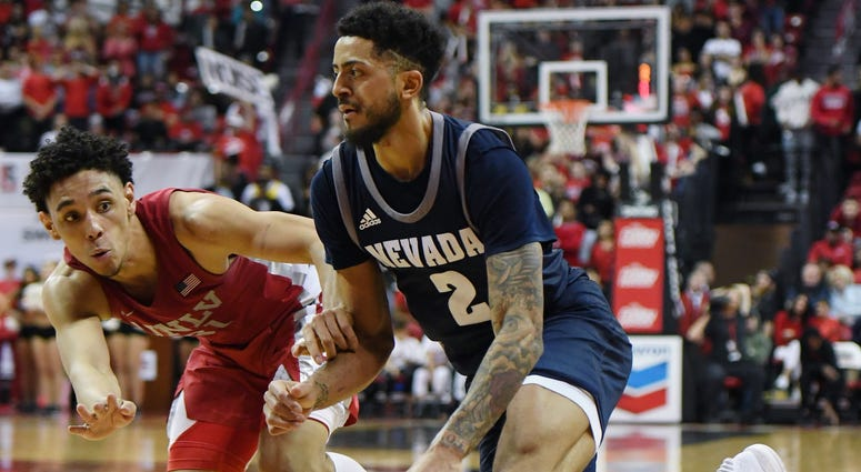 Jalen Harris #2 of the Nevada Wolf Pack drives to the basket against Marvin Coleman #31 of the UNLV Rebels during their game at the Thomas & Mack Center on February 12, 2020