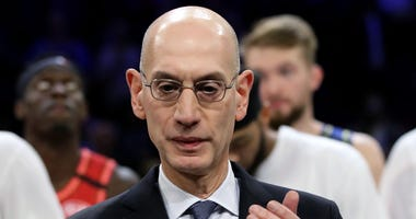NBA Commissioner Adam Silver applauds after Team LeBron beat Team Giannis 157-155 in the 69th NBA All-Star Game