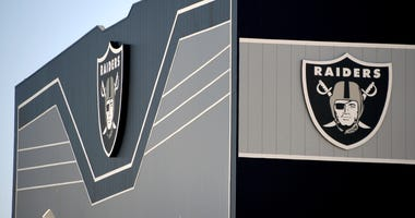 Team logos are shown on the outside of the 336,000-square-foot Las Vegas Raiders Headquarters/Intermountain Healthcare Performance Center under construction on June 10, 2020 in Henderson, Nevada