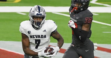 Wide receiver Romeo Doubs #7 of the Nevada Wolf Pack scores a touchdown on a 65-yard pass play against defensive back Sir Oliver Everett #33 of the UNLV Rebels in the first half of their game at Allegiant Stadium on October 31, 2020 in Las Vegas, Nevada.