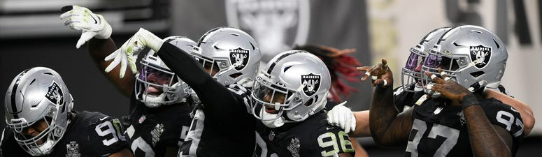 Defensive end Clelin Ferrell #96 of the Las Vegas Raiders celebrates with teammates after a fumble recovery during the second half of their game against the Denver Broncos at Allegiant Stadium on November 15, 2020