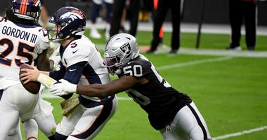 Linebacker Nicholas Morrow #50 of the Las Vegas Raiders sacks quarterback Drew Lock #3 of the Denver Broncos in the first half of their game at Allegiant Stadium on November 15, 2020 in Las Vegas, Nevada.