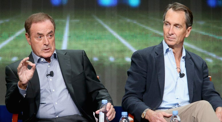 Play-by-play announcer Al Michaels and analyst Cris Collinsworth speak onstage during NBC's 'Sunday Night Football' panel discussion at the NBCUniversal portion of the 2015 Summer TCA Tour at The Beverly Hilton Hotel on August 13, 2015