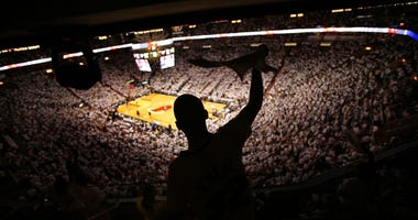 Miami Heat fan Ricardo Ballester cheers on his team against the New Jersey Nets in game two of the Eastern Conference Semifinals during the 2006 NBA Playoffs on May 10, 2006 at the American Airlines Arena in Miami, Florida.