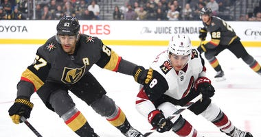Sep 15, 2019; Las Vegas, NV, USA; Vegas Golden Knights left wing Max Pacioretty (67) skates against Arizona Coyotes center Nick Schmaltz (8) during the first period of a preseason game at T-Mobile Arena.