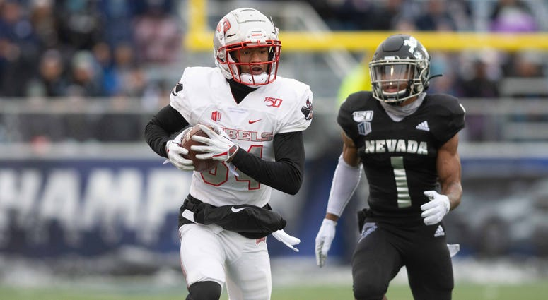 UNLV Rebels wide receiver Steve Jenkins (84) runs after a catch against Nevada Wolf Pack defensive back Berdale Robins (1) at Mackay Stadium