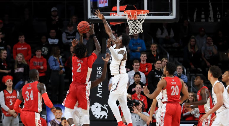 UNLV Rebels forward Donnie Tillman (2) drives to the basket against Cincinnati Bearcats forward Tre Scott (13) in the first game at Fifth Third Arena.