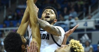 Nevada's Jalen Harris gets a shot off in heavy traffic during the Wolf Pack's 68-67 win over Wyoming.