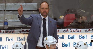 Vegas Golden Knights head coach Peter DeBoer signals to his team on the ice in the third period against the Ottawa Senators at the Canadian Tire Centre.