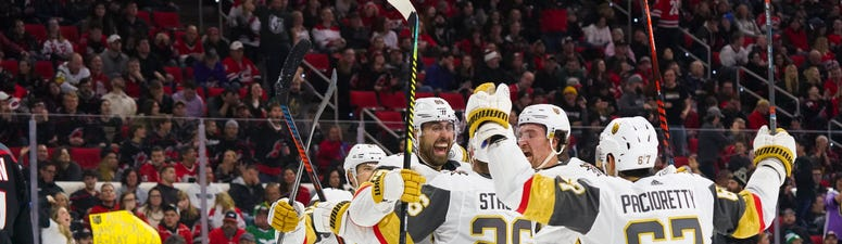 Vegas Golden Knights right wing Alex Tuch (89) is congratulated by center Paul Stastny (26) and right wing Mark Stone (61) and left wing Max Pacioretty (67) after his third period goal against the Carolina Hurricanes at PNC Arena.