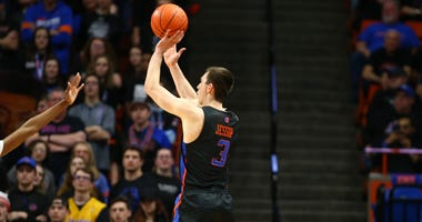 Boise State Broncos guard Justinian Jessup (3) shots a three point basket during the first half against the Nevada Wolf Pack at ExtraMile Arena.