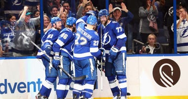 ampa Bay Lightning center Steven Stamkos (91) is congratulated as he scores a goal against the Vegas Golden Knights during the third period at Amalie Arena.