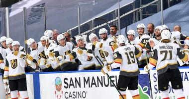 Reilly Smith gets congratulations from teammates after scoring a goal during a preseason game vs. Arizona on 7-30-20