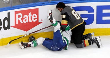 Vegas Golden Knights right wing Alex Tuch (89) fights with Vancouver Canucks right wing Jake Virtanen (18) during the third period in game two of the second round of the 2020 Stanley Cup Playoffs at Rogers Place.