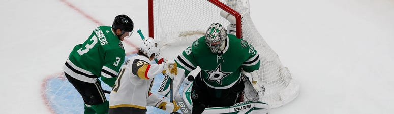 Dallas Stars defenseman John Klingberg (3) and center Joe Pavelski (16) help goaltender Anton Khudobin (35) defend the goal against Vegas Golden Knights center Nick Cousins (21) during the third period in game four of the Western Conference Final