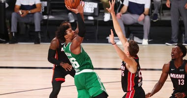 Boston Celtics guard Marcus Smart (36) is fouled as he shoots by Miami Heat guard Duncan Robinson (55) during the second half of game three of the Eastern Conference Finals of the 2020 NBA Playoffs