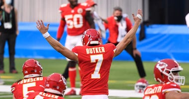 Kansas City Chiefs kicker Harrison Butker (7) celebrates with teammates after kicking the game-winning 58-yard field goal against the Los Angeles Chargers during overtime at SoFi Stadium.