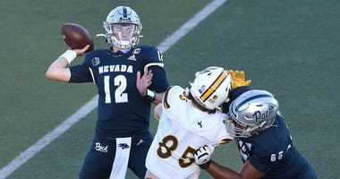 Nevada's QB Carson Strong throws a pass while taking on Wyoming during their football game at Mackay Stadium in Reno on Oct. 24, 2020.