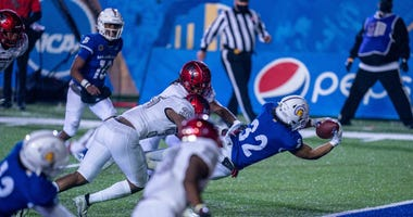 San Jose State Spartans running back Kairee Robinson (32) makes a diving catch for the touchdown against UNLV Rebels linebacker Jacoby Windmon (35) during the third quarter at CEFCU Stadium.