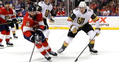 Florida Panthers right wing Brett Connolly (10) skates with the puck as Vegas Golden Knights defenseman Zach Whitecloud (2) defends during the second period of an NHL hockey game, Thursday, Feb. 6, 2020, in Sunrise, Fla.