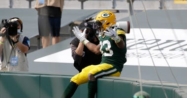 Jones' big day helps Packers maul Lions