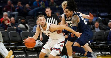 St. Mary's Gaels guard Jordan Ford (3) dribbles away from pressure by Nevada Wolf Pack guard Jazz Johnson during the second half at Chase Center