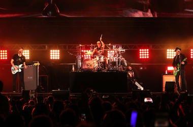 Mark Hoppus, Travis Barker, and Matt Skiba of blink-182 perform onstage at KROQ Weenie Roast 2018