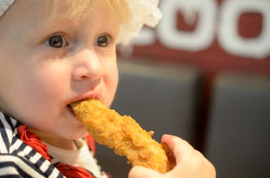 baby eating chicken