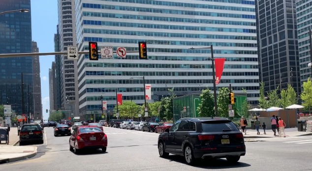 Cars running through a red light in Center City.