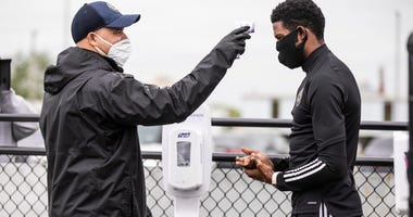 Philadelphia Union players get their temperatures taken before heading into training sessions