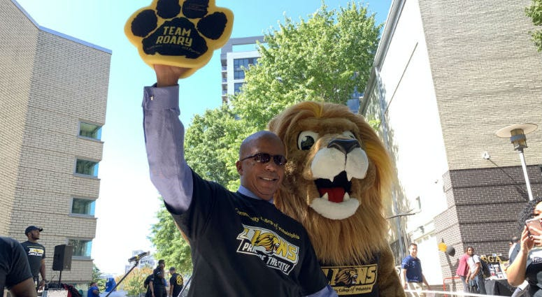 "CCP President Dr. Donald ""Guy"" Generals and the college's new mascot, Roary."