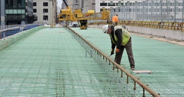 An ironworker checks the rebar as the contractor prepares to pave the westbound side of the Chestnut Street Bridge.