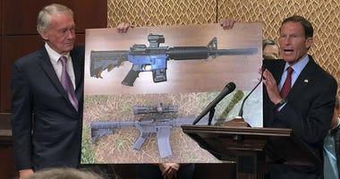 Sen. Edward Markey, D-Mass., left, and Sen. Richard Blumenthal, D-Ct., display a photo of a plastic gun on Tuesday, July 31, 2018, on Capitol Hill in Washington.