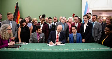 Gov. Tom Wolf signs an executive order creating the Pennsylvania Commission on LGBTQ Affairs on Aug. 6, 2018.