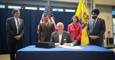 Gov. Phil Murphy signs an executive order to establish a statewide Climate Change Resiliency Strategy on October 29, 2019.