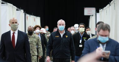 New Jersey Governor Phil Murphy and New Jersey Senator Cory Booker tour the field hospital in Edison, N.J. on Wednesday, April 8, 2020.