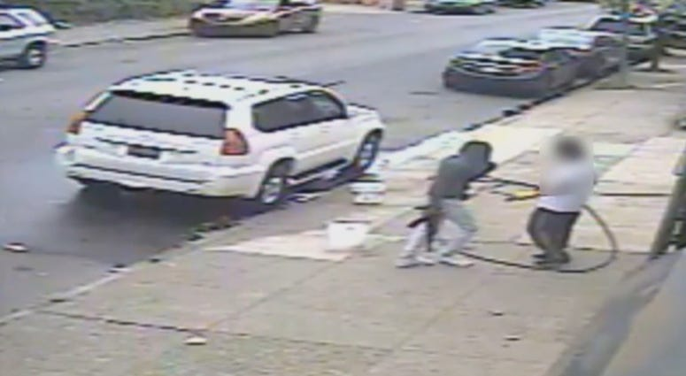 "Video surveillance captures Jovaun Patterson approaching Li ""Mike"" Poeng with an AK-47 at 54th and Spruce streets, May 8, 2018."