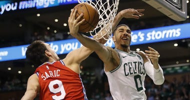 Boston Celtics forward Jayson Tatum and Philadelphia 76ers forward Dario Saric