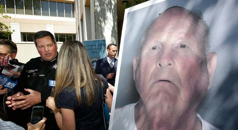 Sacramento County Sheriff Scott Jones, left, talks to reporters about the arrest Joesph James DeAngelo, seen in photo, on suspicion of committing a string of violent crimes in the 1970's and 1980's after a news conference.