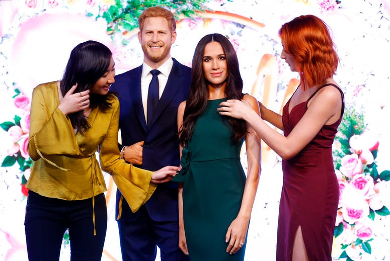 Visitors look at Britain's Prince Harry and his fiancee Meghan Markle who are on display as wax figures at Madame Tussauds in London.