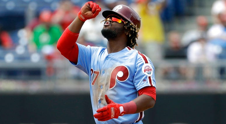 Philadelphia Phillies' Odubel Herrera reacts after hitting a double off San Francisco Giants starting pitcher Ty Blach during the fourth inning.