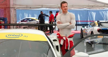 Actor Michael Fassbender gets ready for the Ferarri Challenge practice at the Formula One Canadian Grand Prix auto race in Montreal.